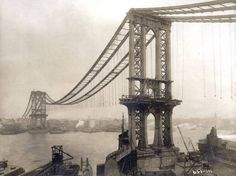 Manhattan Bridge, under-construction, seen from the roof of Robert Gear Building, showing suspenders and saddles, on February 11, 1909.