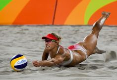 Canada's Heather Bansley dives for a dig during the women's beach volleyball qualifying match between Canada and Germany at the Beach Volley Arena in Rio de Janeiro on August for the Rio 2016 Olympic Games. Beach Volleyball Girls, Volleyball Pictures, Women Volleyball, Vertical Jump Training, Female Volleyball Players, Sports Photos, Woman Beach, Athletic Women, Female Athletes