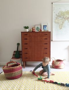"""My husband and I love mid-century design and this Danish teak tall boy was one of our very first furniture purchases. I love that the wood grain on the front matches perfectly on each drawer – it's the finer details!"""