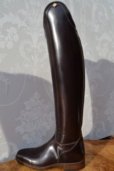 Rafffaello Dressage Boots from Joshua Jones (UK). vailable in a Dark chocolate brown or the most popular Brushed Black. Finished at the top with an elegant shaped detail. Plain leather is used on the inside leg to give a better grip on the saddle.
