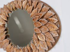 Unique wall mirror, Luxury Golden Mirror, Round mirror wall, Oval Mirror with Golden Leaves, Leaf Design, Chic Wall decor, Gold Home decor, Decorative Mirror, Decor for Living Room, Bedroom Deor, Entry way mirror This unique wall mirror is made of 80+ hand shaped and hand painted clay leaves. I used a Venetian Gold paint to cover them. It looks like if you picked up dried leaves covered with first frost and made an ikebana of them. This mirror in a beautiful frame will fit any neutral or…