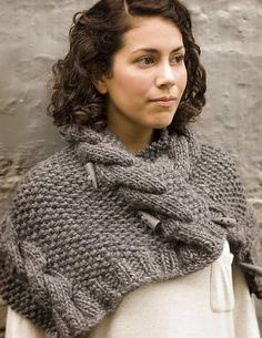 This is a super chunky cowl that can be worn several ways. It has five toggles and no buttonholes so that it can be fastened as a shawl, cowl, hood, or cape.