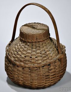 Skinner's - The Personal Collection of Lewis Scranton, Auction 2897M. May 21, 2016. Lot: 175.  Estimate: $400-600.  Realized: $550.   Description:  Woven Splint Bird Carrying Basket, America, 19th century, ht. 15 in.   Provenance: Courcier & Wilkins, 2003.