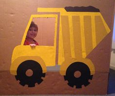 I painted a dump truck on a big cardboard box as a photo prop and it came out sooo cute!