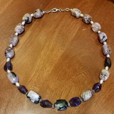 Amethyst And Pearl Beads Stunning amethyst beads with freshwater pearls and silver beads. Lobster claw clasp. 18 inches long No markings, was a gift Jewelry Necklaces