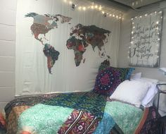 Bohemian style dorm room at Samford University. Dorm bedding from Anthropolgie and world map tapestry and twinkle lights from Urban Outfitters. Custom bible verse headboard from Vintage Soul in Dripping Springs, Texas.
