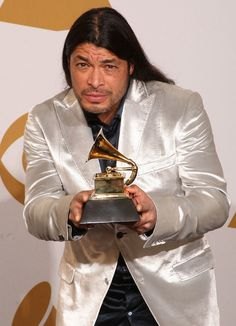 """Robert Trujillo Photos Photos - Musician Robert Trujillo of the band Metallica, winner of the Best Metal Performance award for """"My Apocalypse"""" poses in the press room during the 51st Annual Grammy Awards held at the Staples Center on February 8, 2009 in Los Angeles, California. (Photo by Jason Merritt/Getty Images) * Local Caption * Robert Trujillo - 51st Annual Grammy Awards - Press Room"""