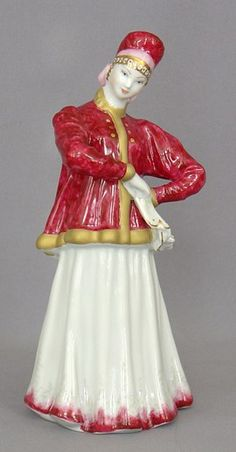 "Porcelain Figurine of a Russian folk dancervdoing the ""Lebedushka"" dance."