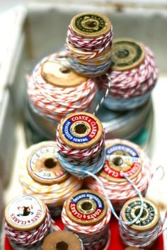 Bakers twine on wooden thread spools - already did this!  So cute!