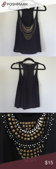 Black Front Studded Tank This is a super cute studded black racerback tanktop. It is a size XS & has been worn only one time!! In great condition. Studs are both silver and a bronze color. Has a loose and flowy fit that is perfect for summer ☀️ From Nordstroms! Starling Tops Tank Tops