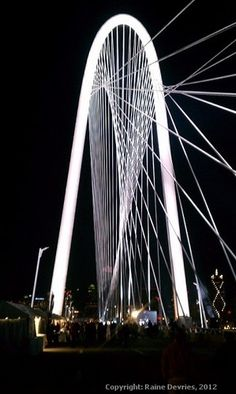Margaret Hunt Hill Bridge - Downtown   Dallas.    The design is Cable-Stayed.   Highest point in the central arch is 400 feet.  Length is 1,200 feet.  Credit: Raine Devries.