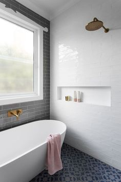 White bathtub with brass shower..very European... It's a wet room. No need for shower curtain, the walls are all tile, and there is a drain in the middle of the floor. So clever, Americans should pick up on this design..no more glass to clean around showers. It's the worst part of having a shower. #tilebathtub