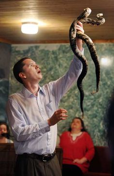 Andrew Hamblin, holds up two rattlesnakes during church service. For more than a 100 years, small Pentecostal churches (Holy Rollers) in East Tennessee and other parts of Appalachia have handled poisonous snakes during their services. Christopher Marley, Southern Gothic, Afraid Of The Dark, East Tennessee, How To Increase Energy, Spirit Animal, My Images, American History, Beautiful Men