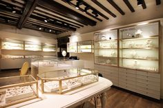 Shop fixtures: Curved display cabinets, perimeter units and till points Toughened glass showcases with slide-out glass drawers Brass vanity mirrors All furniture fixtures are finished with a PU lacquer at 25%