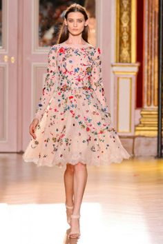 Sweet whimsical dress with bateau neckline, long slim sleeves, fitted waist, full gathered skirt, scalloped edges, and scattered floral embroidery in blues, greens, and reds. Zuhair Murad Couture Autumn 2012