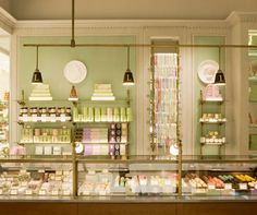 Fresh celadon green, gold metallic accents, thick mouldings, taupe-tinted ceiling.  Laduree shop in France.  http://www.kokoliving.com/.a/6a0120a5d993ef970b0120a97319dd970b-pi