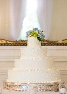 Classic white wedding cake {Photo by Cramer Photo via Project Wedding}