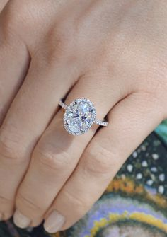 Engagement Ring perfection Oval Cut Halo with a thin, delicate diamond band. By Ascot Diamonds