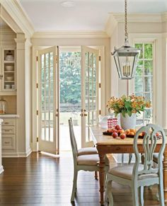 Off white molding color and French doors.