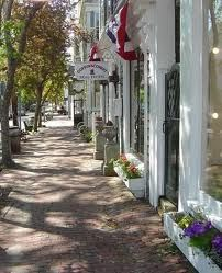 Nantucket . MA . Gorgeous rows of trees, brick sidewalks, window box's of flowers & charming store fronts •