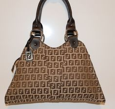 """This unusual and rare Fendi handbag has the traditional double """"F"""" jacquard, double leather handles and detailing.  It comes with a dust cover and certification card.    www.handbagconsignmentshop.com"""