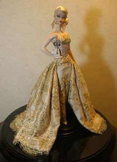 Charity Auction for the 2008 National Barbie Doll Collector's Convention.    French lace in gold over blush colored silk, hand beaded with micro sequins and champagne colored crystals.  Winning bid of $6000  www.mattsutton.com