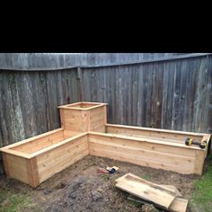 Add height to raised beds on end closest to fountain. Instead of potted trees.