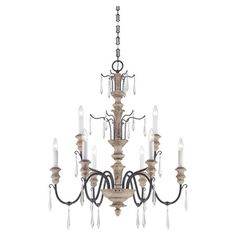 Cast a sophisticated glow over your dining room or foyer decor with this elegantly turned chandelier, featuring sweeping arms and spear-cut crystal accents.