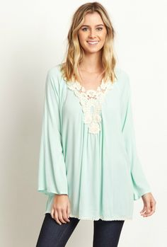 This gorgeous blouse has all of our favorite things. A pretty crochet neckline and a flowy material will instantly transform any casual look into something beautiful. Style this blouse with jeans and booties for a complete ensemble you can wear all day and night.