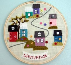 felt houses and embroidery.  Hoop art