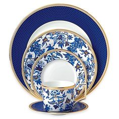 Wedgwood's stunning Hibiscus Dinnerware Collection, is inspired by a pattern from 1810 that has been transformed for sophisticated 21st century dining. Gorgeous and opulent, its vibrant blue florals are hand-lined in 22K gold on fine bone china.