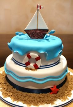 "beach cake - I like the ""wave"" fondant on top :)"