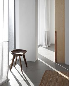 curated by minimalism.co — stool in sunny corner