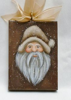 My hand painted Santa Mimi canvas is 2 1/2 X 3 1/2. He hangs from a metal eye with a brown ribbon. Sealed with satin varnish, signed and dated by