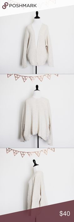 "{Brandy Melville} | Cream Caroline Cardigan Brandy Melville ∥ One Size  ➳ Quick Description: Doesn't have the Brandy tag, but it has the made in Italy tag. ➳ Material: 80% cotton, 20% linen ➳ Color: cream ➳ Condition: good, slight wear  Remember that the color always vary in person! It may not look the same because true colors are hard to capture. Feel free to leave a comment with any other concerns. I would prefer offers be made through the ""offer"" button. No trades. No holds. Thank you for…"