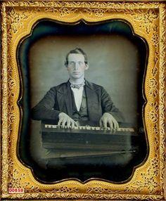 daguerreotype portrait of a gentleman playing lap organ or piano