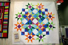 Designed by Beach Garden Quilts, the quilt is made from their fabulous Eagle Harbor Summer quilt pattern.