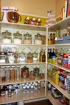 I will have a pretty, pretty pantry like this one. Also, she has the cleverest idea for ModPodging fabric onto contact paper and using that as wallpaper.