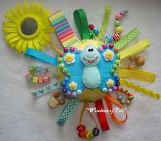 For your baby this toy. Makes a wonderful travel toy whether on a lap in the car seat or stroller, a quiet busy activity while waiting for