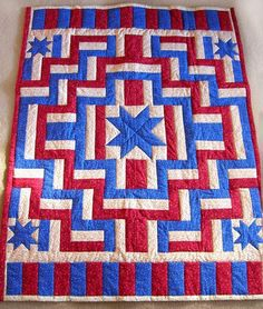 I love this quilt. I love the rail fence block mixed with the stars & the piano key border.