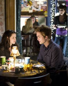 """I love this scene in """"Twilight"""" where Edward makes sure Bella has something to eat....in the background they play Robert Pattinson's song on the soundtrack."""