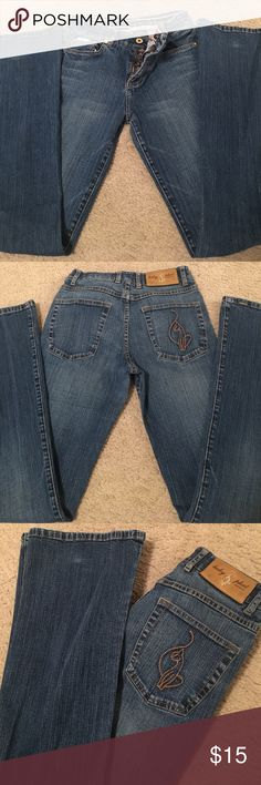 Denim Baby Phat Jeans👖🌸💕 Denim Baby Phat Jeans so comfortable, with the perfect wash!!! I love these Jeans! They are perfect for any occasion whether going out or staying in!! Size: 3 ( 96% Cotton, 4% Spandex, 96% Algodon, 4% Spandex) Happy Poshing!! Comes from a smoke-free home:)🌸👖🌵 Baby Phat Jeans Flare & Wide Leg
