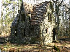 """Stone house in the forest of Denmark: When the Germans were in Denmark in World War II, they took over a man's farm. This man moved into the deep forest and made this house of stone. Around the house is a moat."""