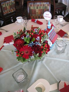 Red and blue centerpiece by Designs by Courtney, via Flickr