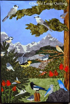 Birds of the North American Cordillera. An original quilted wallhanging designed by Debbie Lange and Eric Lange. Features the gray jay, red-breasted nuthatch, mountain chickadee, ruby-crowned kinglet (male), dark-eyed junco, rufous hummingbird (male and female), black-billed magpie, and mountain bluebird (male and female). All these birds can be found in the Grand Teton National Park. I can make a custom keepsake quilt for you. email to: DebbieLangeQuilting@gmail.com
