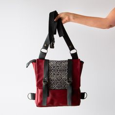Model Holding A Red Leather - Recycled Leather & Cotton Backpack / Shoulder Bag - Handmade in Canada - Chic & Basta