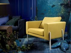 Sit back and relax in IKEA KOARP armchair. It brings a modern comfort to your living room in a happy yellow colour.