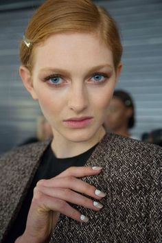 The look was similar at Jenni Kayne (left), where models were manicured with OPI Don't Pretzel My Buttons and a stark white moon of OPI Alpine Snow.
