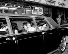 The Beatles leave Hotel Warwick in a limousine for Shea Stadium. August 23, 1966