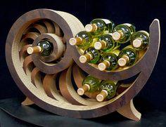 Sculptural wine racks from corrugated cardboard by artist Jeff Podergois.